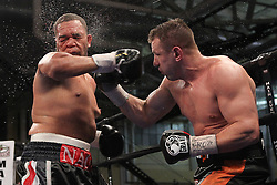 Mar 24; Newark, NJ, USA; Tomasz Adamek (Black/Orange trunks) and Nagy Aguilera (Black/Red trunks) trade punches during their 10 round heavyweight bout at the Aviator.