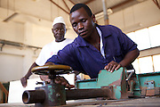 Mr. Kulwa Mdula teaching a woodwork workshop at VETA college in Mtwara, where he works alongside VSO volunteer  Michael Padden.