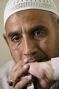 "A Shiite religious man, Abu Fatimha, who would only give a nickname for fear of reprisals against him, talks about his life at the Imam Aba Al Fa Thill Abbas Holy Shrine in Karbala, Iraq, Monday, July 21, 2003. ..He said in 1991 Saddam killed women and children in and near the shrine and bulldozed their bodies into mass graves. Doctors Without Borders has promised to help identify the 1000's of bones, but, they've had no luck in finishing the daunting task...""The people do not have the trust they had for America,"" he said.""The American government says it catches Aziz, Chemical Ali and all these others but, never shows these criminals to us to prove it.'Why all the secrecy? It's like a play or movie from Hollywood.""..He said their people do not want to be the rulers; they just want the freedom to speak their minds and not be attacked.. .Fatimha is one of several men whose job it is to administer, organize, secure, lead tours, make announcements, keep lost and found items safe, etc. at the Imam Hussein and Imam Aba Al Fa Thill Abbas Holy Shrines in Karbala who have not been paid for 3 months since the fall of Saddam Hussein...A shiite, he was in prison for 8 years for practicing his faith. He has helped to found a group for former prisoners."