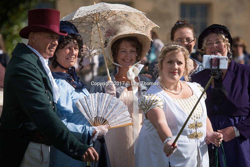 Bath, Somerset, UK. 9th September 2017. Pictured:  Selfies seemed the order of the day as costumed participants assembled at Royal Crescent Lawn prior to the Promenade. /  Around 600 people dressed in period attire take part in the Grand Regency Costumed Promenade in Bath marking the 200th anniversary of the English novelist Jane Austen's death. The Promenade commenced mid-morning from the world famous Royal Crescent Lawn and made its way through the historic Georgian streets and main shopping area of the city before finishing at Parade Gardens. In 2014 the Jane Austen Festival achieved the Guinness World Record TM for 'The largest gathering of people dressed in Regency costumes'. The Somerset city is currently host to the 17th annual Jane Austen Festival with an expected 4000 visitors taking part in events such as film screenings, book readings, workshops, dances, balls, talks, concerts and theatricals. // Lee Thomas, Tel. 07784142973. Email: leepthomas@gmail.com  www.leept.co.uk (0000635435)