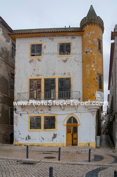 Narrow alley in the old town (Praia) of Nazare, Portugal