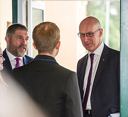 Pictured: Mr Swinney was greeted by head boy and girl Sophie Gardiner and Kyle Rowan<br /> <br /> Education Secretary  John Swinney visited Firrhill School today and met students and parents as the results wer available for opening.<br /> <br /> <br /> Ger Harley | EEm 7 August 2018