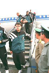 VLADIKAVKAZ, RUSSIA - Monday, September 11, 1995: Liverpool's Phil Charnock and players step off the Aeroflot plane at Vladikavkaz airport as the team arrive in Russia ahead of the UEFA Cup 1st Round 1st Leg match against FC Alania Spartak Vladikavkaz. (Photo by David Rawcliffe/Propaganda)