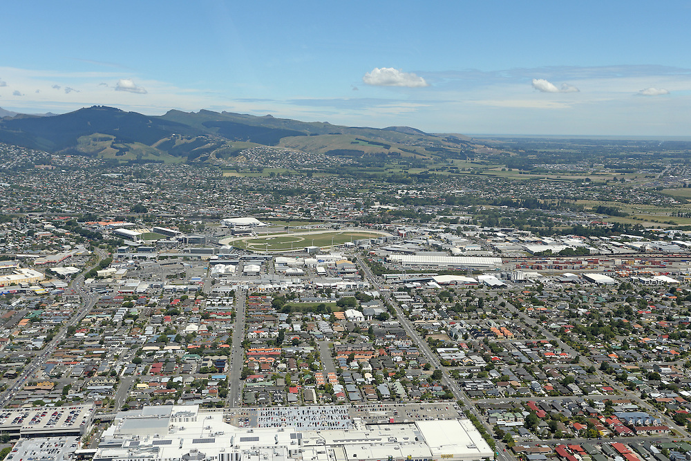 Aerial view over the city with the Riccarton Mall in the foreground and AMI stadium and Addington Raceway to the rear, Christchurch, New Zealand, Wednesday, 11 December, 2013.    Credit: SNPA / Pam Carmichael