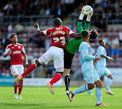 Bristol City's Marvin Elliott challenges Coventry City's Joe Murphy  - Photo mandatory by-line: Dougie Allward/JMP - Tel: Mobile: 07966 386802 11/08/2013 - SPORT - FOOTBALL - Sixfields Stadium - Sixfields Stadium -  Coventry V Bristol City - Sky Bet League One