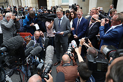 England cricketer Ben Stokes's lawyer Paul Lunt reads out a statement outside Bristol Crown Court where he has been found not guilty of affray following a brawl hours after England played the West Indies in a one-day international in the city in September last year.
