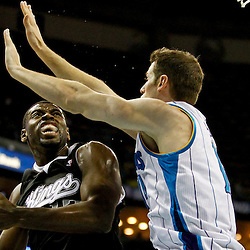 Jan 21, 2013; New Orleans, LA, USA; Sacramento Kings point guard Tyreke Evans (13) shoots over New Orleans Hornets power forward Jason Smith (14) during the second half of a game at the New Orleans Arena. The Hornets defeated the Kings 114-105. Mandatory Credit: Derick E. Hingle-USA TODAY Sports