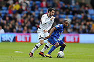 Conor McLaughlin of Millwall (l) and Junior Hoilett of Cardiff City (r) in action. EFL Skybet championship match, Cardiff city v Millwall at the Cardiff city stadium in Cardiff, South Wales on Saturday 28th October 2017.<br /> pic by Andrew Orchard, Andrew Orchard sports photography.