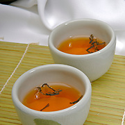 Green chinese tea cups and tea leaves ready to serve tea