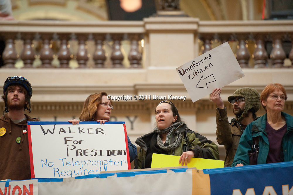 An anti-Walker protester mocks a supporter of the Governor during protests at the state Capitol in Madison, Wisconsin on February 25, 2011.       (Photo by Brian Kersey)