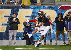 Sep 8, 2018; Morgantown, WV, USA; West Virginia Mountaineers wide receiver Marcus Simms (8) catches a pass during the third quarter against the Youngstown State Penguins at Mountaineer Field at Milan Puskar Stadium. Mandatory Credit: Ben Queen-USA TODAY Sports