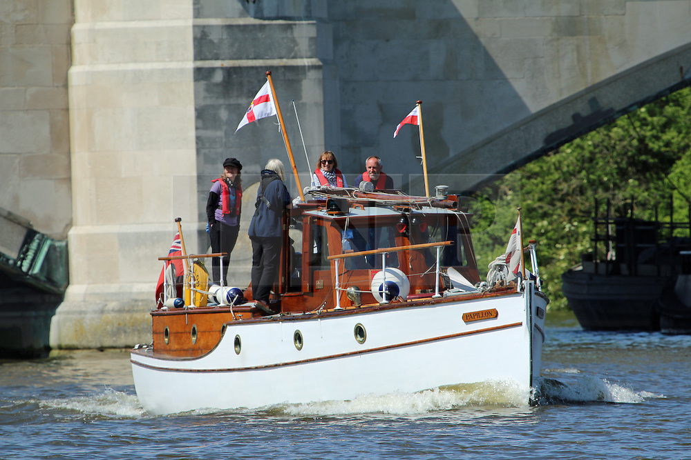 © Licensed to London News Pictures. 16/05/2015.  A procession of famous Dunkirk little ships made their way along the Thames as part of their journey to London, the Ramsgate and then on to Dunkirk to renact their famous act in saving soldiers during the war.  The scene on a beautiful sunny day by Chiswick Bridge across the Thames. Credit : Rob Powell/LNP