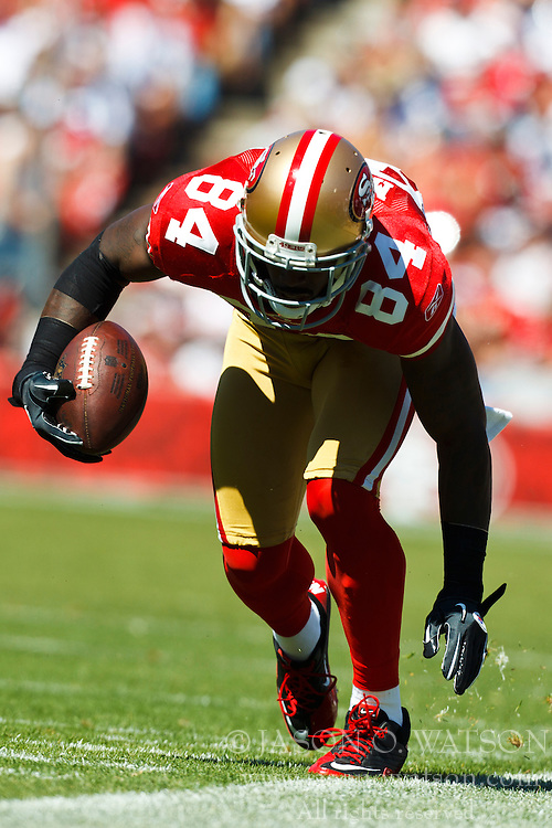September 18, 2011; San Francisco, CA, USA;  San Francisco 49ers wide receiver Josh Morgan (84) makes a pass reception along the sidelines against the Dallas Cowboys during the second quarter at Candlestick Park.  Dallas defeated San Francisco 27-24 in overtime.