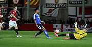 Rai Simons calmly chips FC Unted keeper during the The FA Cup match between FC United of Manchester and Chesterfield at Broadhurst Park, Manchester, United Kingdom on 9 November 2015. Photo by Pete Burns.