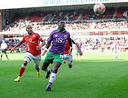 Bristol City's Kieran Agard battles for the ball with Walsall's Adam Chambers  - Photo mandatory by-line: Joe Meredith/JMP - Mobile: 07966 386802 - 04/10/2014 - SPORT - Football - Walsall - Bescot Stadium - Walsall v Bristol City - Sky Bet League One