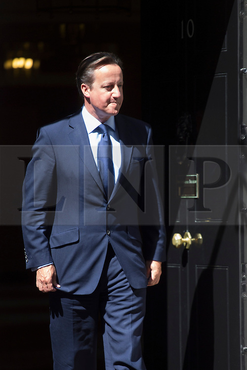 © licensed to London News Pictures. London, UK 06/08/2013. Prime Minister David Cameron leaving No10 to welcome King of Bahrain, Hamad bin Isa Al Khalifa on Downing Street on Tuesday, August 08, 2013. Photo credit: Tolga Akmen/LNP