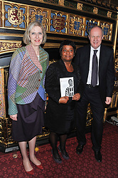 Left to right, The Home Secretary THERESA MAY MP, DOREEN LAWRENCE and the Justice Minister DAMIEN GREEN MP at a reception for the Stephen Lawrence Charitable Trust hosted by the Speaker of The House of Commons John Bercow and supported by law firm Freshfields Bruckhaus Deringer in The State Rooms, Speaker's House, the House of Commons, London on 19th December 2012.