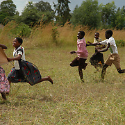 Malawi. Children playing catch. Richard in the centre (pink shirt ) is blind