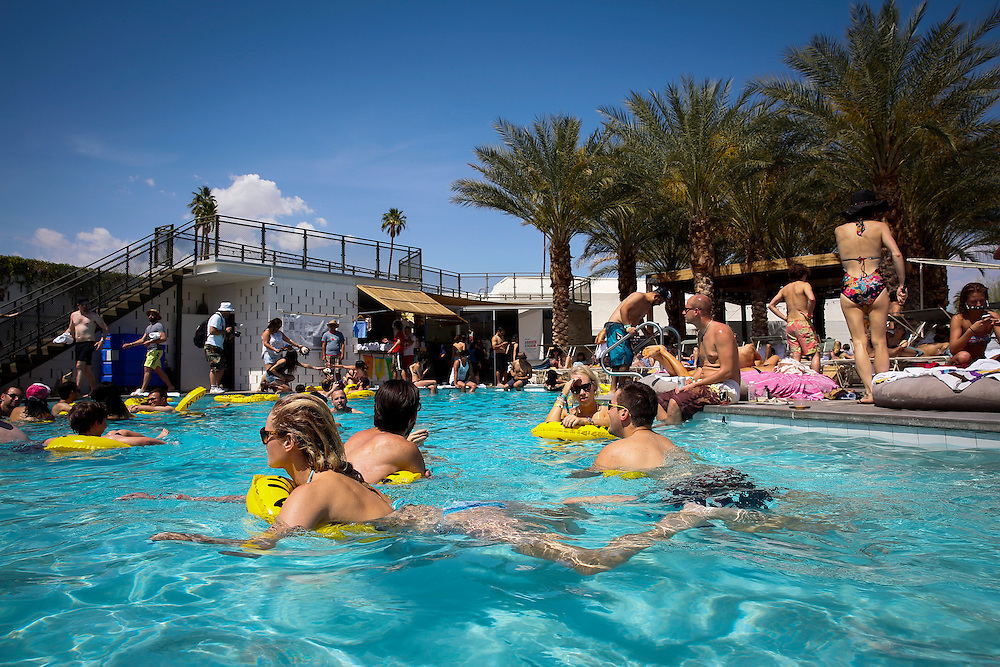 INDRE KALTENIS, left, swims in the pool during the Desert Gold 2014 pool party at the ACE Hotel & Swim Club, Coachella weekend on Saturday, April 19, 2014 in Palm Springs, California.© 2014 Patrick T. Fallon, No Use Without Permission