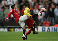 Photo: Lee Earle.<br /> Watford v Manchester United. The Barclays Premiership. 26/08/2006. United's Cristiano Ronaldo (L) beats Chris Powell to the ball.
