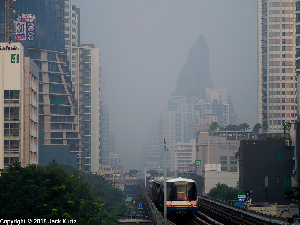 12 FEBRUARY 2018 - BANGKOK, THAILAND: Hazy skies obscure the Bangkok skyline as seen from the Ekkamai BTS (light rail) station.   PHOTO BY JACK KURTZ