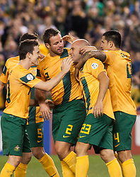 © Licensed to London News Pictures. 11/6/2013. The Australian team celebrate after Mark Bresciano scores a goal during the FIFA World Cup Qualifying match between Australia Vs Jordan at Docklands stadium, Melbourne, Australia.. Photo credit : Asanka Brendon Ratnayake/LNP