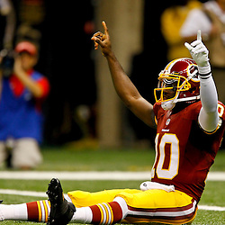 September 9, 2012; New Orleans, LA, USA; Washington Redskins quarterback Robert Griffin III (10) celebrates a touchdown against the New Orleans Saints during the first quarter of a game at the Mercedes-Benz Superdome. Mandatory Credit: Derick E. Hingle-USA TODAY SPORTS