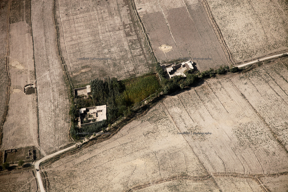 Aerial view down on a typical compound in Northern Afghanistan in the Kunduz/Baghlan area, seen from a Helicopter.