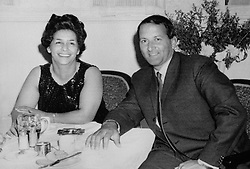 Basil D'Oliveira, the South African born cricketer, is shown here with his wife, Naomi, celebrating at a Plymouth Hotel after the MCC's decision that he would be replacing Warwickshire's Thomas Cartwright on the forthcoming South African Tour.