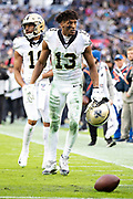 NASHVILLE, TN - DECEMBER 22:  Michael Thomas #13 of the New Orleans Saints picks up the ball during a game against the Tennessee Titans at Nissan Stadium on December 22, 2019 in Nashville, Tennessee. The Saints defeated the Titans 38-28.  (Photo by Wesley Hitt/Getty Images) *** Local Caption *** Michael Thomas