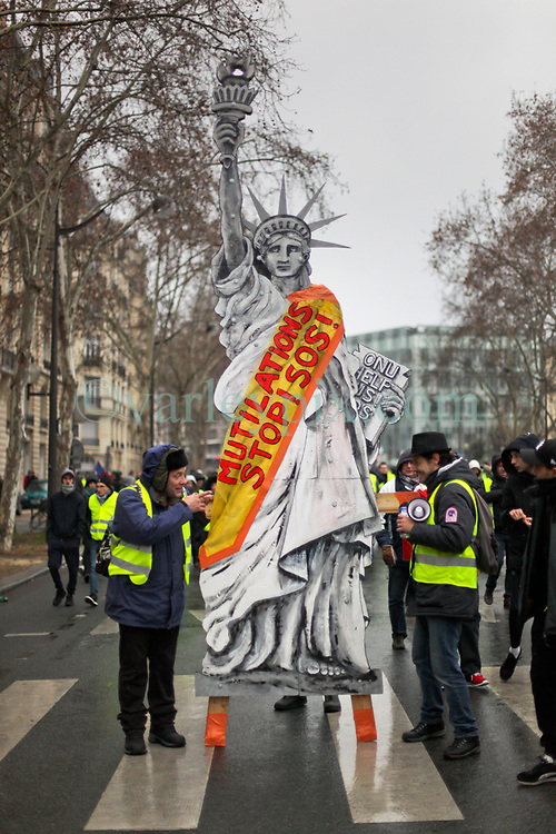 19 January 2019. Paris, France.<br /> Gilets Jaunes - Acte X take to the streets of Paris. The Statue of Liberty makes an appearance. An estimated 7,000 people took part in the looping 14 km route from Place des Invalides to protest tax hikes from the Government of Emmanuel Macron imposed on the people. An estimated 80,000 people took part in protests across the country. Regrettably the movement has attracted a violent element of agitators who often face off with riot police at the end of the marches which tends to deflect attention away from the message of the vast majority of peaceful protesters.<br /> Photo©; Charlie Varley/varleypix.com