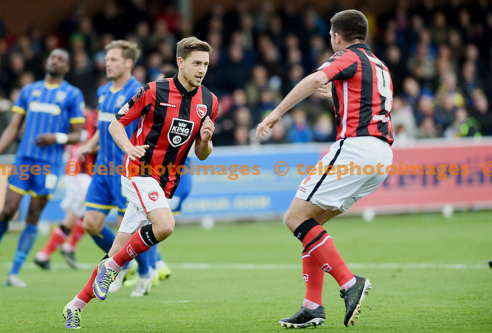 Shaun Miller of Morecambe scores from the penalty spot for his first goal during the Sky Bet League 2 match between AFC Wimbledon and Morecambe at the Cherry Red Records Stadium in Kingston. October 17, 2015.<br /> Simon  Dack / Telephoto Images<br /> +44 7967 642437
