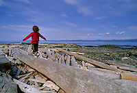 Girl, 8-10, balances on log, Hornby Island, BC