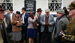 © Licensed to London News Pictures. <br /> 15/10/2016. <br /> Pickering, UK.  <br /> <br /> Enthusiasts dressed in 1940's clothing stand outside a pub in Pickering during the North Yorkshire Moors Railway Wartime Weekend event. <br /> The annual event brings together re-enactors and enthusiasts along the length of the NYMR heritage steam railway line to recreate the feel of the war years of the 1940's. <br /> <br /> Photo credit: Ian Forsyth/LNP
