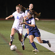 NEWTON, PA - NOVEMBER 4: Villa Joseph Marie's Bridget Galen #5 battles for control of the ball as Conrad Weiser's Kennedy Lutz #5 defends in the first half of the PIAA Class AA first-round girls soccer playoff game November 4, 2014 in Newtown, Pennsylvania.  (Photo by William Thomas Cain/Cain Images)