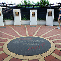 CLEVELAND, OH USA - JULY 6: Cleveland Indians fan Joe Smith, 31,  of Springfield, OH. walks through Heritage Park, a place where Indians greats have been enshrined, during the game between the Cleveland Indians and the New York Yankees at Progressive Field in Cleveland, OH, USA on Wednesday, July 6, 2011.