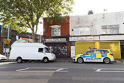© Licensed to London News Pictures. 08/08/2019. London, UK.  Police and the white van at the scene in Leyton this morning in Leyton High Road, where a police officer has been left in a critical condition after being stabbed repeatedly whilst attempting to stop a van in east London. The injured Police Officer, believed to be aged in his thirties, was rushed to hospital and is in a critical but stable condition..  Photo credit: Vickie Flores/LNP