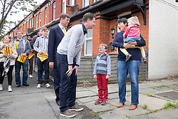© Licensed to London News Pictures. 26/04/2015. Sutton, UK.  NICK CLEGG, PAUL BURSTOW meet the Bourne family who live on Orchard Road.  leaflets Orchard Road in Sutton.  Deputy Prime Minister and Leader of the Liberal Democrats Nick Clegg makes a speech today, 26th April 215 in Sutton, to local Liberal Democrats in support of the candidate for Sutton and Cheam, Paul Burstow. Nick Clegg and Paul Burstow also joined local campaigners to deliver leaflets on a nearby street, and put up a Liberal Democrat stakeboard.. Photo credit : Stephen Simpson/LNP