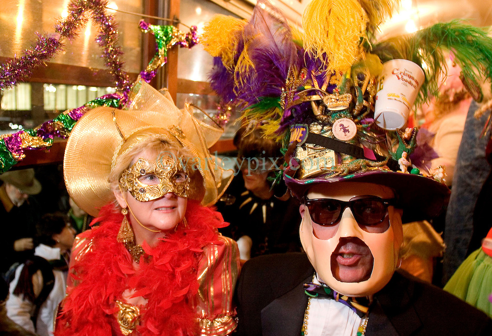 06 Jan, 2006. New Orleans, Louisiana.  Post Katrina aftermath.<br /> 12th Night, New Orleans, Louisiana. Mardi Gras begins. The Mardi Gras krewe of Phunny Phorty Phellows gather on Canal Street to take a street car through the city. Their traditional route along St Charles Ave had to be cancelled because street cars are still unable to travel the route.  A couple take their seats on the street car.<br /> Photo; Charlie Varley/varleypix.com