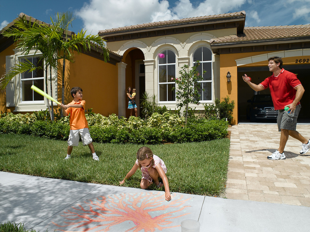 Lifestyle family home with family playing