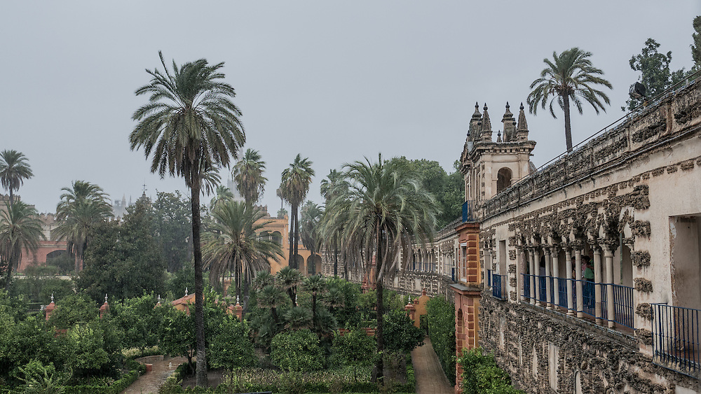 """A rare rainy day at the """"Reales Alcázares de Sevilla."""" Originally developed by Moorish Muslim kings, the palace is renowned as one of the most beautiful in Spain. The upper levels of the Alcázar are still used by the royal family as the official Seville residence."""
