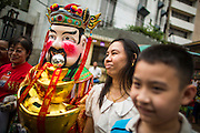"10 FEBRUARY 2013 - BANGKOK, THAILAND:  A person dressed as a Chinese deity walks through the crowd soliciting donations for a temple during Chinese New Year celebrations on Yaowarat Road in Bangkok. Bangkok has a large Chinese emigrant population, most of whom settled in Thailand in the 18th and 19th centuries. Chinese, or Lunar, New Year is celebrated with fireworks and parades in Chinese communities throughout Thailand. The coming year will be the ""Year of the Snake"" in the Chinese zodiac.   PHOTO BY JACK KURTZ"