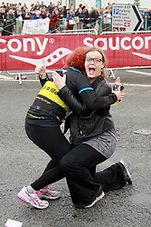 © Licensed to London News Pictures. 06/04/2014. Brighton, UK. Lucy gives the thumbs up after her proposal is excepted. A marriage proposal took place during the Brighton Marathon today 6th April. Lucy Beasley proposed to Chantelle Dunstan who was running the marathon for Guidedogs.org. Photo credit : Hugo Michiels/LNP