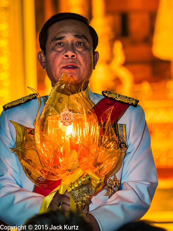 05 DECEMBER 2015 - BANGKOK, THAILAND:  PRAYUTH CHAN-OCHA, the Prime Minister of Thailand, sings the King's Anthem on the King's Birthday on Sanam Luang in Bangkok. Prayuth was the commander of the Thai army and seized power in a bloodless coup in 2014. Thais marked the 88th birthday of Bhumibol Adulyadej, the King of Thailand,  Saturday. The King was born on December 5, 1927, in Cambridge, Massachusetts. The family was in the United States because his father, Prince Mahidol, was studying Public Health at Harvard University. He has reigned since 1946 and is the world's currently the longest serving monarch in the world and the longest serving monarch in Thai history. Bhumibol, who is in poor health, is revered by the Thai people. His birthday is a national holiday and is also celebrated as Father's Day. He is currently hospitalized in Siriraj Hospital, recovering from a series of health setbacks.   PHOTO BY JACK KURTZ
