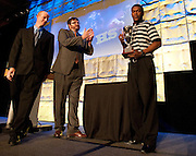 DeSoto running back Dontre Wilson is awarded the SportsDayHS offensive player of the year by Matt Wixon and Corbett Smith at SportsDayHS' third-annual football Heroes Banquet at the Omni Hotel on Thursday, January 17, 2013 in Dallas. (Cooper Neil/The Dallas Morning News)