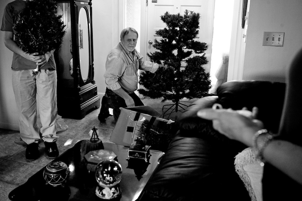 Bob Mobley, center, and wife Alicia, right, decorate their Christmas tree with their grandson Brandon, left, for the first time since their son died in 2009.