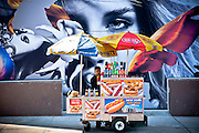Food cart parked in front of a billboard in the Meatpacking District, Manhattan, New York