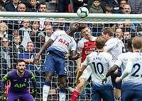 Football - 2018 / 2019 Premier League - Tottenham Hotspur vs. Arsenal<br /> <br /> Laurent Koscielny (Arsenal FC) and Davinson Sanchez (Tottenham FC) compete for the header at Wembley Stadium.<br /> <br /> COLORSPORT/DANIEL BEARHAM