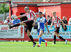 Arron Downes of Cheltenham Town clears from Daniel Leadbitter of Bristol Rovers - Mandatory by-line: Neil Brookman/JMP - 25/07/2015 - SPORT - FOOTBALL - Cheltenham Town,England - Whaddon Road - Cheltenham Town v Bristol Rovers - Pre-Season Friendly