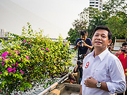 17 FEBRUARY 2013 - BANGKOK, THAILAND: Pheu Thai gubernatorial candidate PONGSAPAT PONGCHAREON on the riverbank of the Chao Phraya River during a campaign rally in Bangkok Sunday. Pol General Pongsapat Pongcharoen, a former deputy national police chief who also served as secretary-general of the Narcotics Control Board is the Pheu Thai Party candidate in the upcoming Bangkok governor's election. (He resigned from the police force to run for Governor.) Former Prime Minister Thaksin Shinawatra reportedly recruited Pongsapat. Most of Thailand's reputable polls have reported that Pongsapat is leading in the race and likely to defeat Sukhumbhand Paribatra, the Thai Democrats' candidate and incumbent. The loss of Bangkok would be a serious blow to the Democrats, whose base is the Bangkok area.      PHOTO BY JACK KURTZ